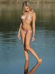 Excellent pictures of a sexiest blonde girl with svelte body posing her enticing nudeness at the lake
