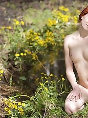 Amazing teen girl with beautiful body is posing her most sensitive parts on the nature.