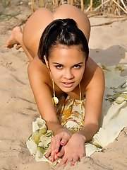 Alluring teen cutie poses naked on a rushy bank and bends over to show her shaven holes.